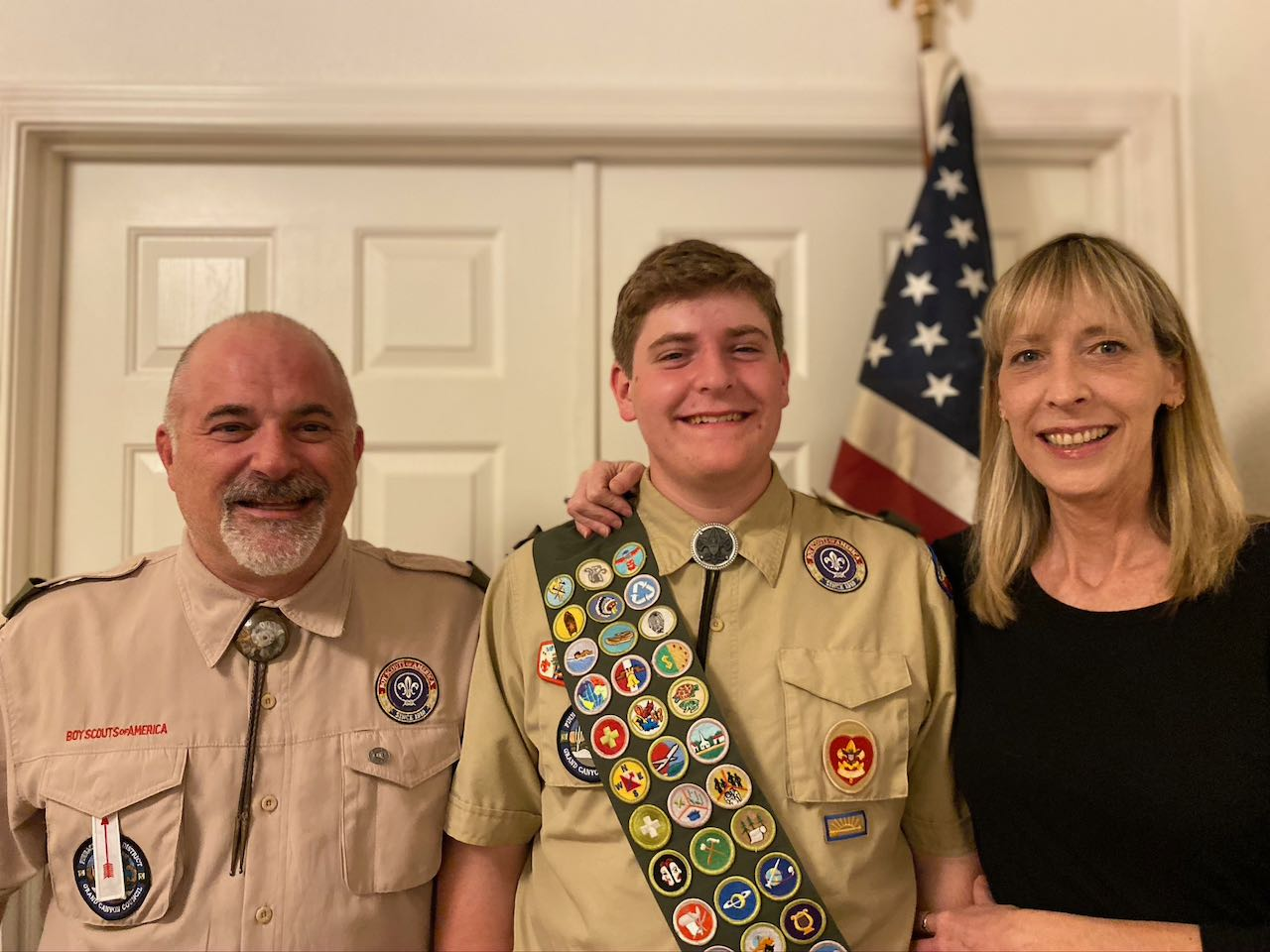 Eagle scout with parents